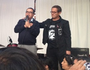 Fathers of two of the deceased, Daniel and Ignacio, speaking at the benefit show